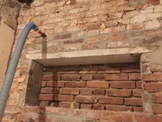 Doppelschaliges Mauerwerk mit Glaswolle WLG 034 von innen verfüllt