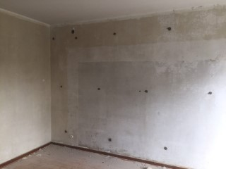 Zweischaliges Mauerwerk mit Knauf Supafil WLG 035 von innen ausgeblasen